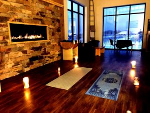 Yoga mats next to a fireplace inPlanters Ridge Winery